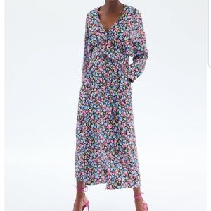 Long dress with wrap V-neckline and long sleeves.